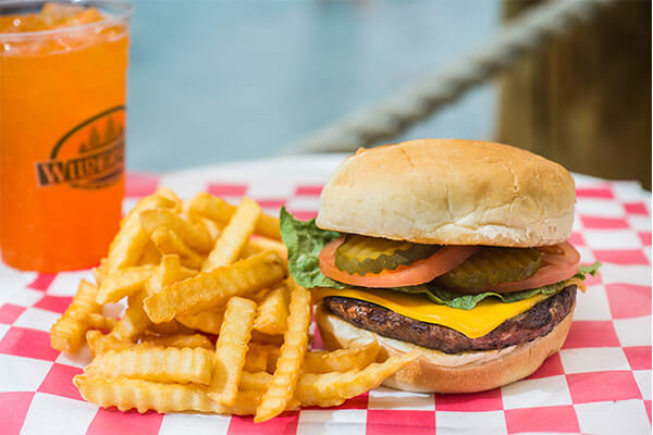 cheeseburger with french fries basket with a drink