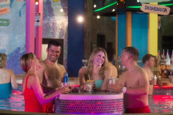 two couples having drinks at margarita's swim up bar