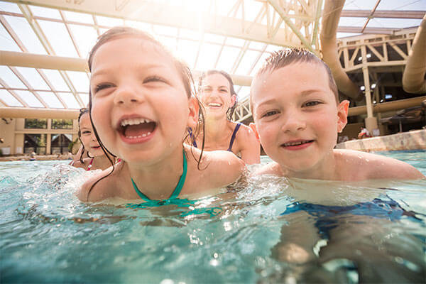 children in the wave pool